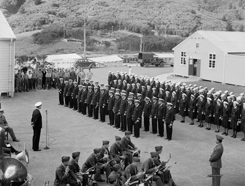Parade of officers, nurses and marines hearing an order read at the opening of the US Naval Hospital at Silverstream, Upper Hutt.